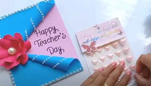 Blue Pink teachers day card with flowers